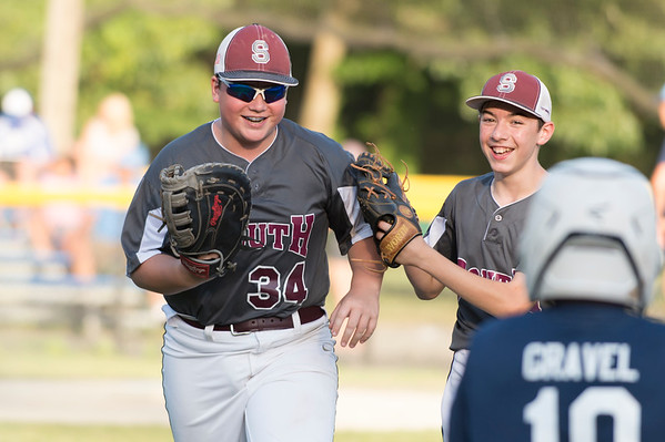 07/09/19 Wesley Bunnell | Staff Southington North vs Southington South in a Little League playoff game on Tuesday July 9, 2019 at Bill Petit Field. Evan Wilcox (34) runs off the field with Joe Grata (8) after an inning ending play at first.
