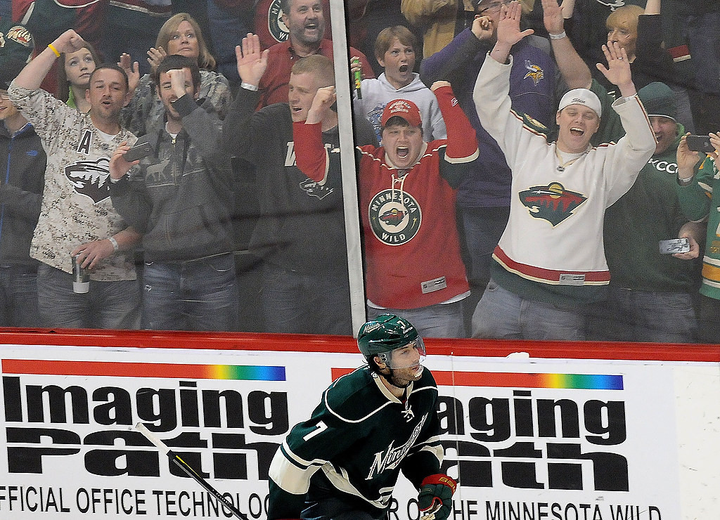 . Wild fans go crazy at the glass after Minnesota Wild center Matt Cullen (7), bottom, scored the winning goal during a shootout. (Pioneer Press: Sherri LaRose-Chiglo)