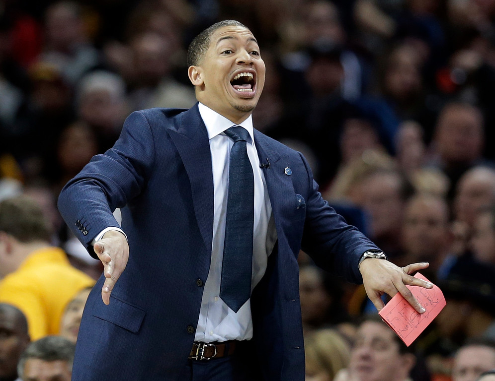 . Cleveland Cavaliers head coach Tyronn Lue yells to players in the first half of an NBA basketball game against the Chicago Bulls, Saturday, Jan. 23, 2016, in Cleveland. (AP Photo/Tony Dejak)