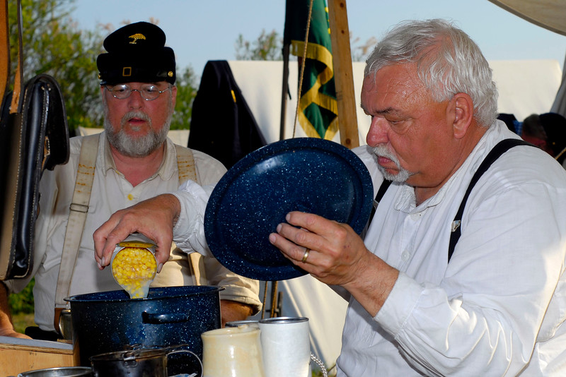 Reenactor Lieutenant Ronnie Overby (right) cooks a meal at Ft. Moultrie in Sullivan's Island, South Carolina on Monday, April 11, 2011. ..The 150th Anniversary of the Firing on Ft. Sumter was commemorated with lectures, performances, demonstrations, and a living history throughout the area on James Island, Charleston, Mt. Pleasant, and Sullivan's Island during the week from April 8-14, 2011. Photo Copyright 2011 Jason Barnette