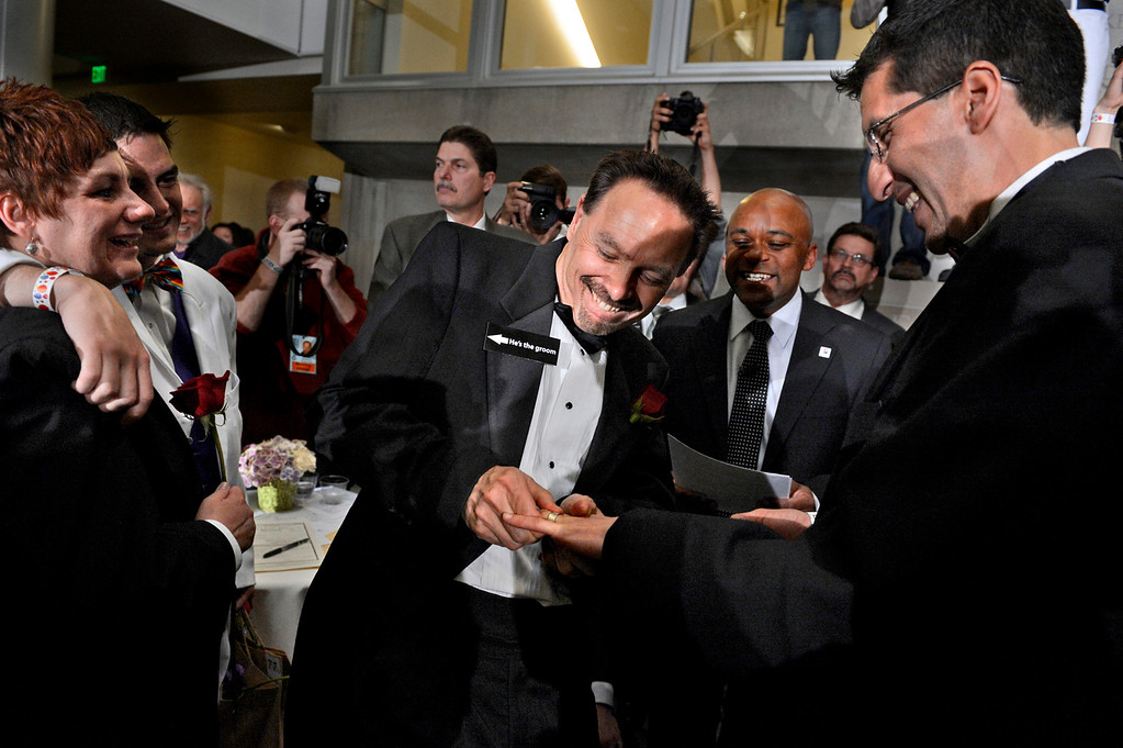 . David Westman struggles putting a ring on Anthony Aragon\'s finger during their civil-union ceremony at the Wellington E. Webb Municipal Office Building in Denver on May 1, 2013.