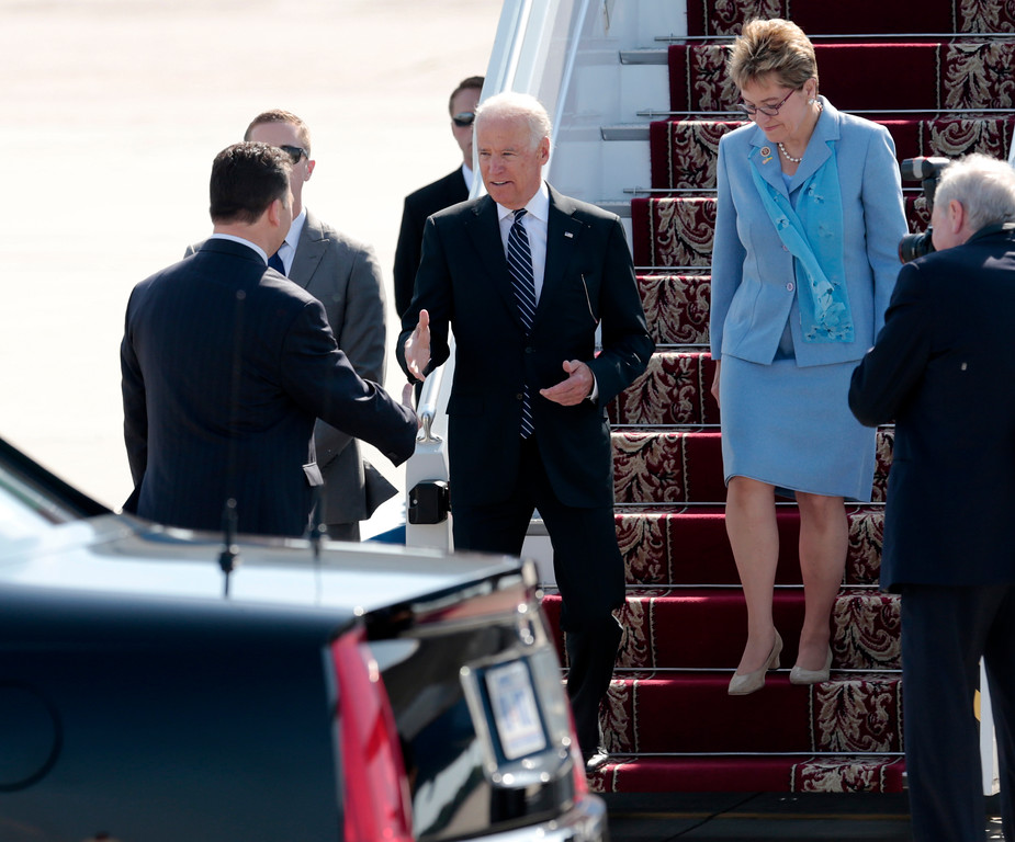 . U.S. Vice President Joe Biden, left, walks from Air Force Two upon arrival at Borispil international airport outside Kiev, Ukraine, Saturday, June 7, 2014. Biden is here to attend the inauguration of Petro Poroshenko as the President of Ukraine on Saturday. At right is Rep. Marcy Kaptur, D-Ohio. (AP Photo/Petro Zadorozhnyy)