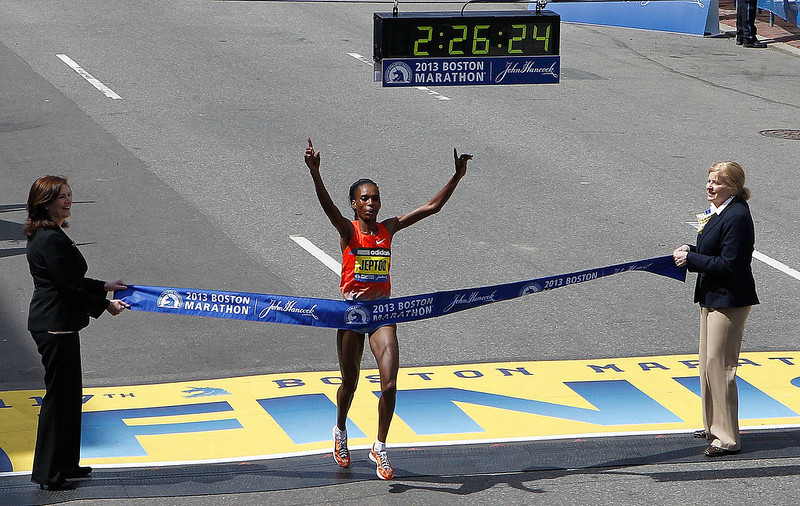 . Rita Jeptoo of Kenya crosses the finish line to win the women\'s division of the 117th Boston Marathon on April 15, 2013 in Boston, Massachusetts.  (Photo by Jim Rogash/Getty Images)