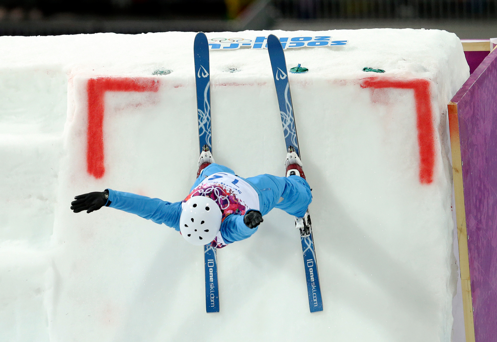 . Alla Tsuper of Belarus launches off the ramp for her final jump in the women\'s freestyle skiing aerials final at the Rosa Khutor Extreme Park, at the 2014 Winter Olympics, Friday, Feb. 14, 2014, in Krasnaya Polyana, Russia.  (AP Photo/Sergei Grits)