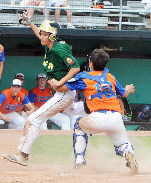 KYLE MENNIG - ONEIDA DAILY DISPATCH Oneida Post's Jorden Barlow (13) tags Vestal Post's Shawn Chermak out at the plate during the New York State Junior American Legion Baseball championship game in Utica on Saturday, July 30, 2016.