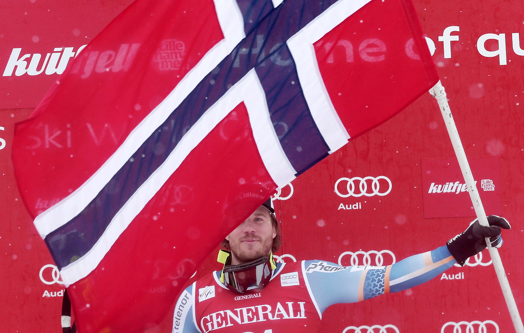 . Winner Norway\'s Kjetil Jansrud celebrates with the Norwegian flag on the podium after the men\'s Super-G competition at the FIS Ski World Cup on March 2, 2014 in Kvitfjell, Norway. Swiss Patrick Kueng placed 2nd, Austria\'s Matthias Mayer placed 3rd in the event.   DANIEL SANNUM LAUTEN/AFP/Getty Images