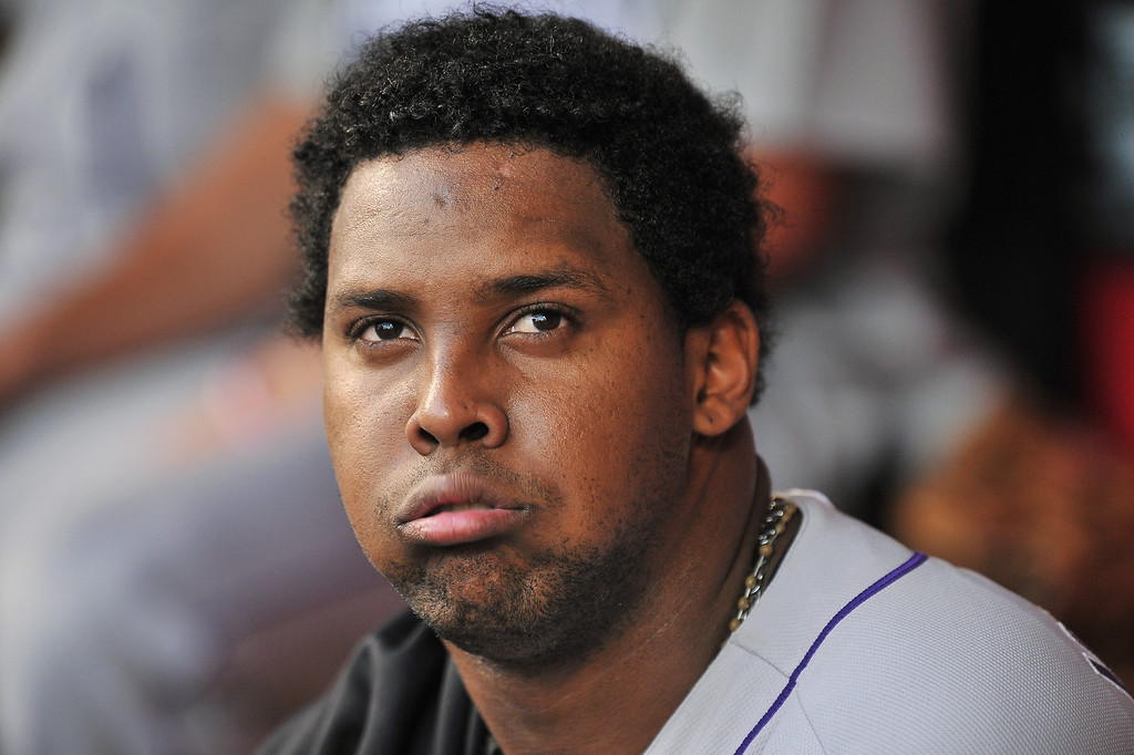 . Pitcher Juan Nicasio #44 of the Colorado Rockies takes a breather in the dugout in the fourth inning against the Cincinnati Reds at Great American Ball Park on June 4, 2013 in Cincinnati, Ohio.  (Photo by Jamie Sabau/Getty Images)