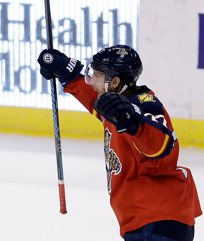 . Florida Panthers defenseman Tom Gilbert (77) celebrates after scoring against the Colorado Avalanche during the third period of an NHL hockey game in Sunrise, Fla., Friday, Jan. 24, 2014. The Avalanche won 3-2. (AP Photo/Alan Diaz)