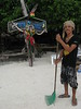 'Mood', the owner of 'Time to Chill' sweeping the beach in preparation for another day serving guests.