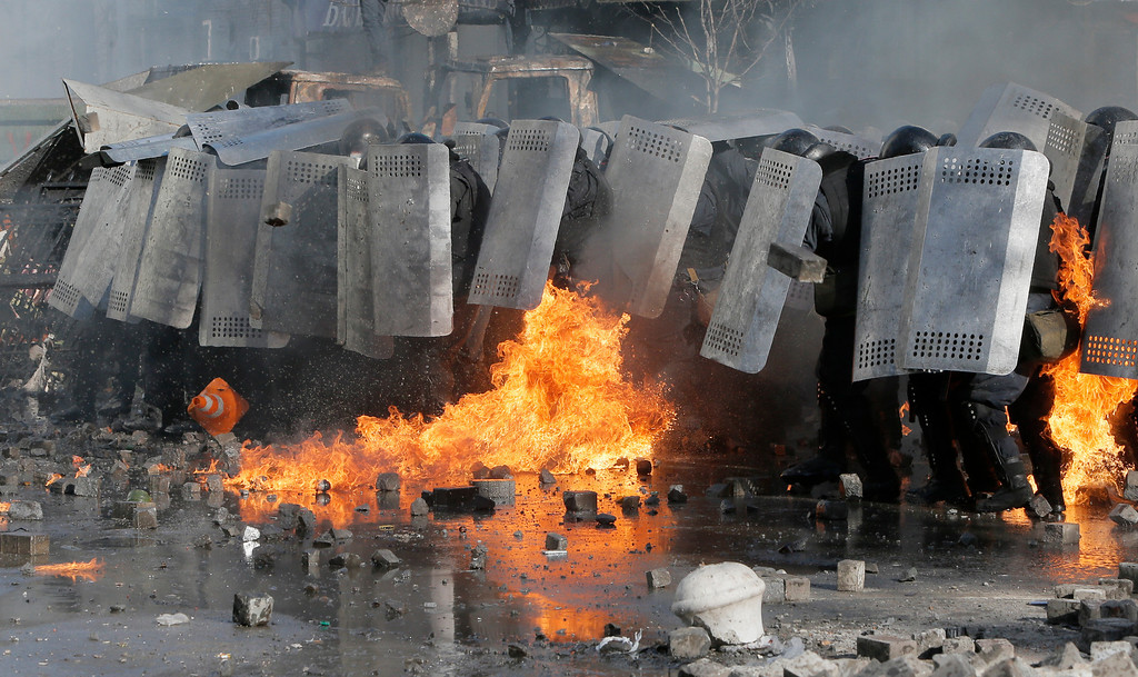 . Riot police clash with anti-government protesters outside Ukraine\'s parliament in Kiev, Ukraine, Tuesday, Feb. 18, 2014. Some thousands of anti-government protesters clashed with police in a new eruption of violence Tuesday. (AP Photo/Efrem Lukatsky)