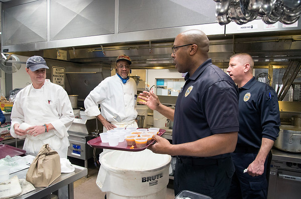 01/30/20 Wesley Bunnell   StaffrrThe annual SOUPerBowl to benefit the Friendship Centers Soup Kitchen took place on Thursday Jan 30, 2020 at E.C. Goodwin Technical School. New Britain Fire Inspectors Ryan Stewart and Joe Dicicco speak with chefs from The Friendship Center while putting together samples for the judges.
