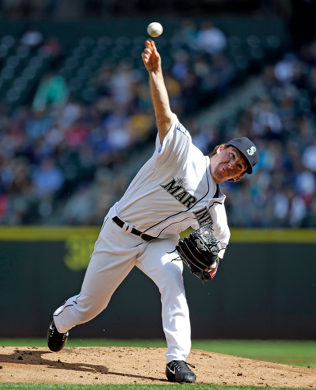 . Seattle Mariners starting pitcher Andrew Moore throws against the Cleveland Indians in the first inning of a baseball game Saturday, Sept. 23, 2017, in Seattle. (AP Photo/Elaine Thompson)
