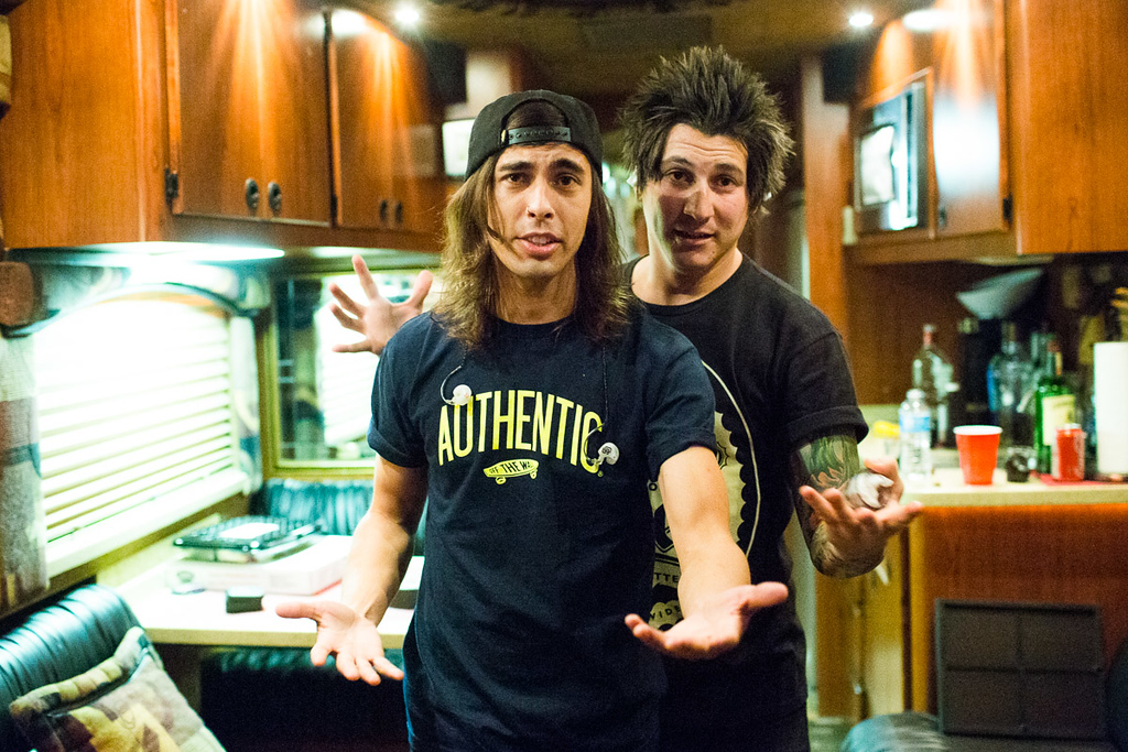 Vic and Jaime lip singing to some slow song on the bus as a warm up
