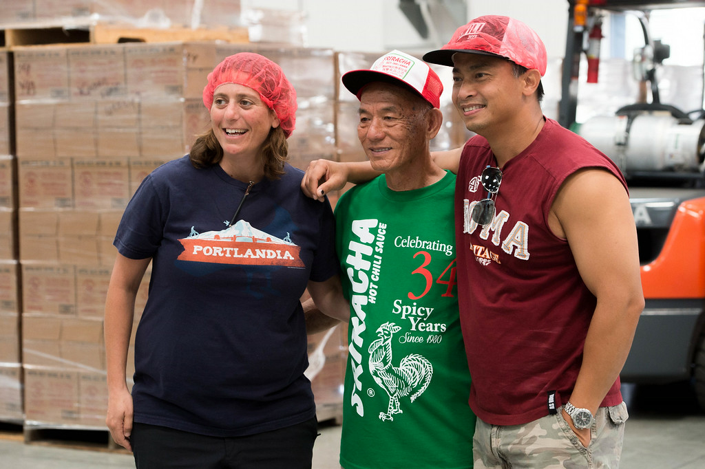 . Huy Fong CEO David Tran, center, gets his picture taken with guests during tour at the Sriracha hot sauce factory in Irwindale on Friday, August 22, 2014. (Photo by Watchara Phomicinda/ Pasadena Star-News)