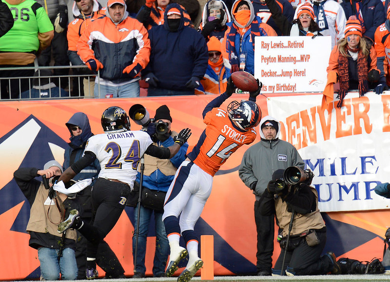 . Denver Broncos wide receiver Brandon Stokley (14) makes a 15-yard touchdown catch in the first quarter. The Denver Broncos vs Baltimore Ravens AFC Divisional playoff game at Sports Authority Field Saturday January 12, 2013. (Photo by Joe Amon,/The Denver Post)