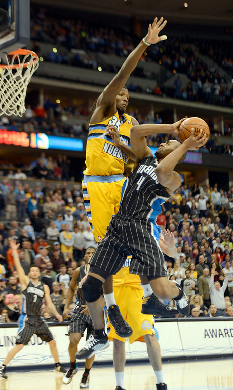. Orlando Magic shooting guard Arron Afflalo (4) tries to tget s shot off over Denver Nuggets small forward Kenneth Faried (35) during the fourth quarter Wednesday, January 9, 2013 at Pepsi Center. John Leyba, The Denver Post