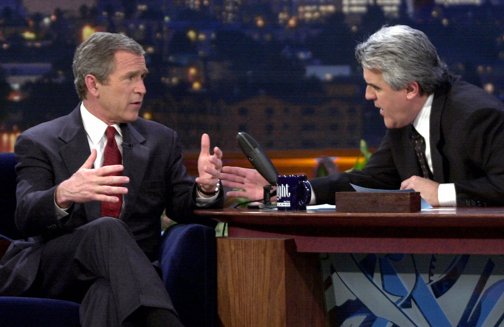 ". Republican presidential candidate Texas Gov. George W. Bush talks to Jay Leno during an appearance on ""The Tonight Show with Jay Leno\"" in Burbank, Calif., Monday, March 6, 2000.  (AP Photo/Eric Draper)"
