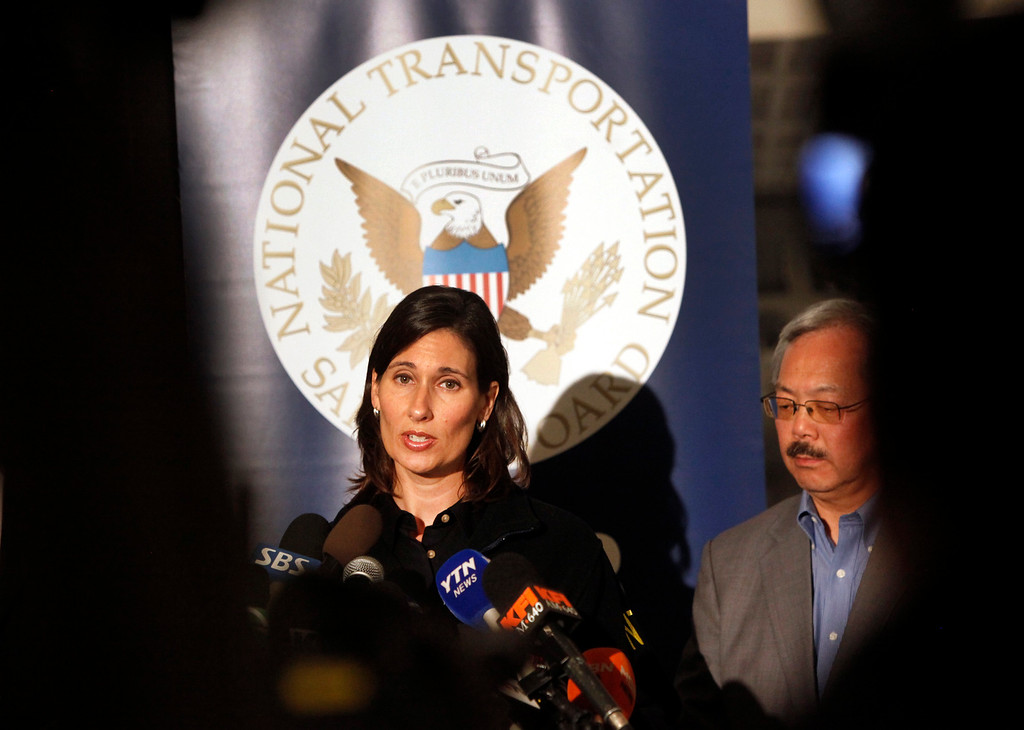 . Deborah Hersman, chair of the National Transportation Safety Board, briefs reporters at San Francisco Airport Sunday afternoon, July 7, 2013, one day after an Asiana Airlines jet crashed killing two people. San Francisco Mayor Ed Lee joined her at the press conference. (Karl Mondon/Bay Area News Group)