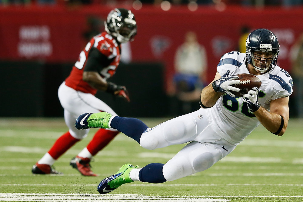 . Zach Miller #86 of the Seattle Seahawks pulls down a second quarter reception against the Atlanta Falcons during the NFC Divisional Playoff Game at Georgia Dome on January 13, 2013 in Atlanta, Georgia.  (Photo by Kevin C. Cox/Getty Images)