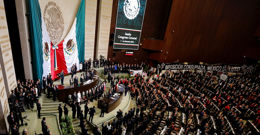 . Mexico\'s new President Enrique Pena Nieto listens to the national anthem after taking oath at congress in Mexico City December 1, 2012. Enrique Pena Nieto took over as Mexican president on Saturday, offering a shot at redemption for the party that shaped modern Mexico if he can bring an end to years of violence and economic underperformance. REUTERS/Tomas Bravo
