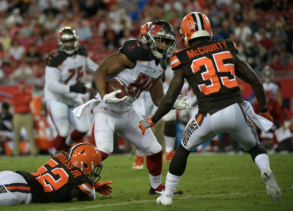 . Tampa Bay Buccaneers tight end O.J. Howard (80)eludes Cleveland Browns defensive back Jason McCourty (35) during the third quarter of an NFL preseason football game Saturday, Aug. 26, 2017, in Tampa, Fla. (AP Photo/Phelan Ebenhack)