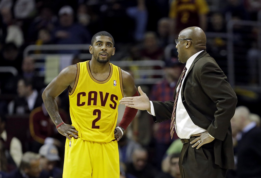 . Cleveland Cavaliers head coach Mike Brown talks to point guard Kyrie Irving (2) in an NBA basketball game against the Memphis Grizzlies Sunday, Feb. 9, 2014, in Cleveland. (AP Photo/Mark Duncan)