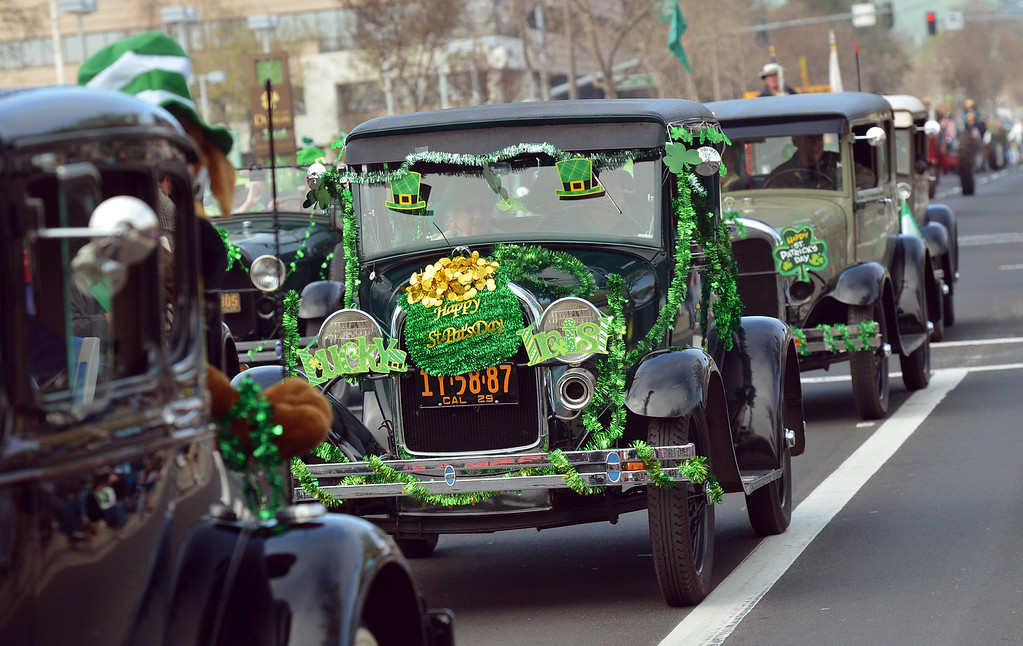 . Old cars covered with Saint Patrick\'s Day attire drive down Dublin Boulevard during the Saint Patrick\'s Day Parade in Dublin, Calif., on Saturday, March 16, 2013. (Dan Rosenstrauch/Staff)