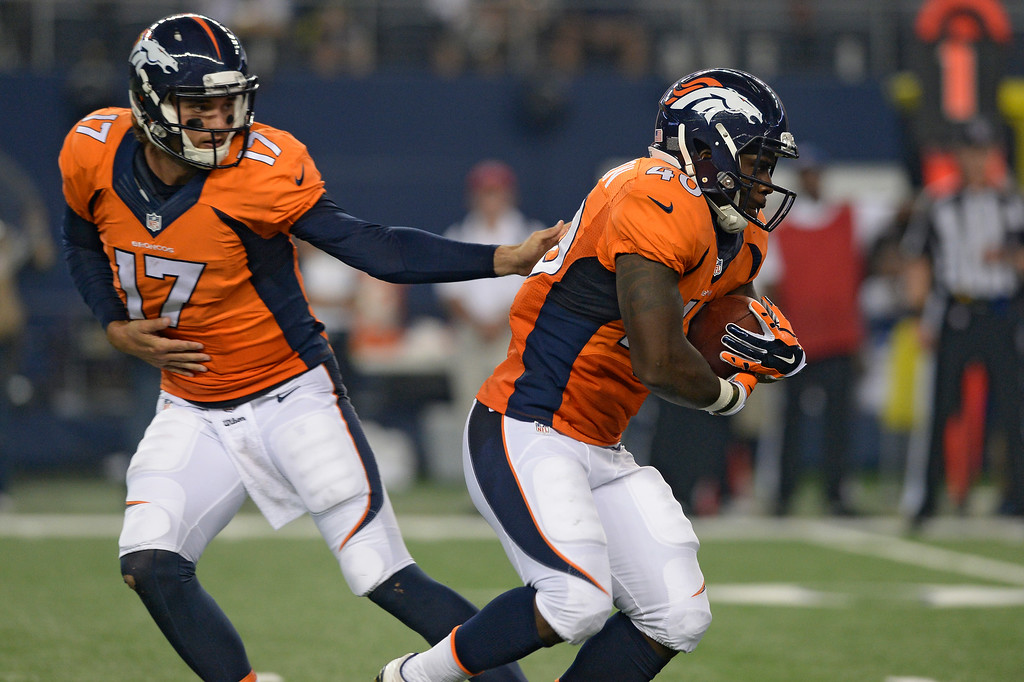 . ARLINGTON, TX - AUGUST 28: Denver Broncos quarterback Brock Osweiler (17) hands off to Denver Broncos running back Juwan Thompson (40) during the third quarter against the Dallas Cowboys August 28, 2014 at AT&T Stadium. (Photo by John Leyba/The Denver Post)
