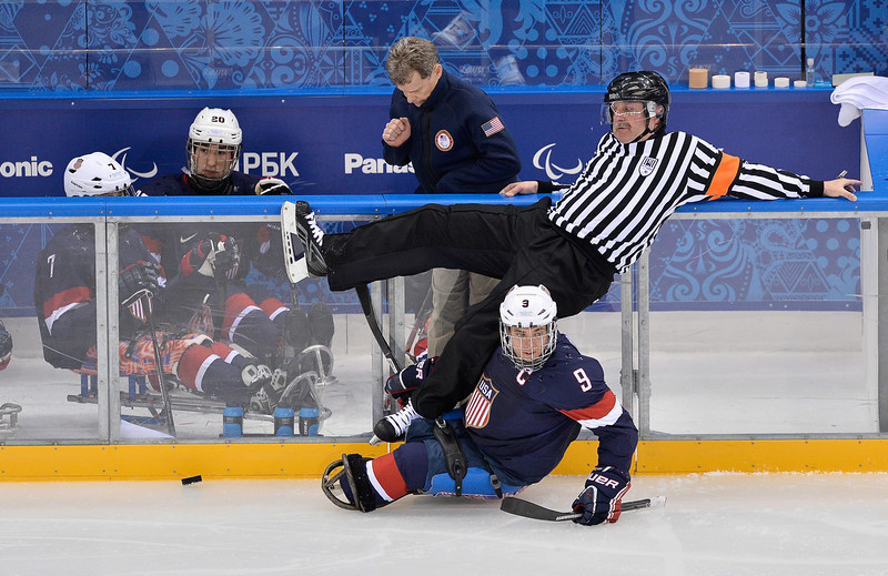 . Referee Paul Boese  takes a fall during the Ice Sledge Hockey Preliminary Round Group A match between the United States of America and Italy at Shayba Arena on March 8, 2014 in Sochi, Russia.  (Photo by Justin Setterfield/Getty Images)