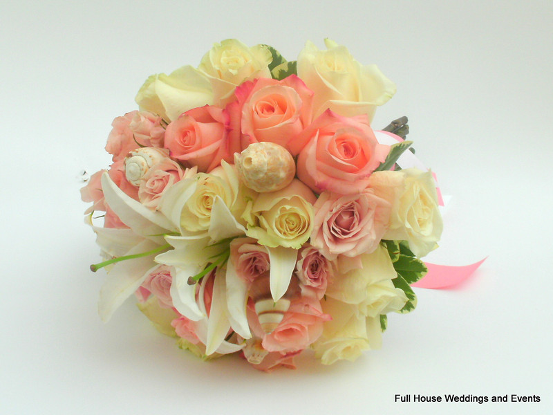 Bouquet - Peach, Light Pink and Ivory Roses, Casablanca Lilies, Pittosporum, accented with shells.