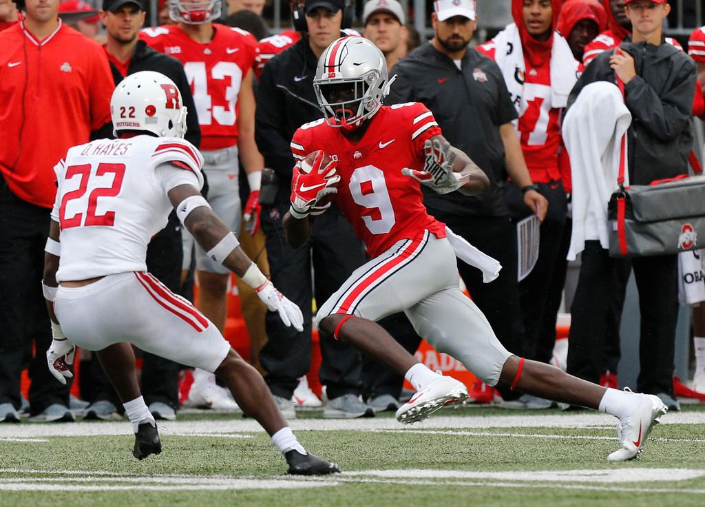 . Ohio State receiver Binjimen Victor, right, tries to avoid Rutgers defensive back Damon Hayes during the second half of an NCAA college football game Saturday, Sept. 8, 2018, in Columbus, Ohio. Ohio State beat Rutgers 52-3. (AP Photo/Jay LaPrete)