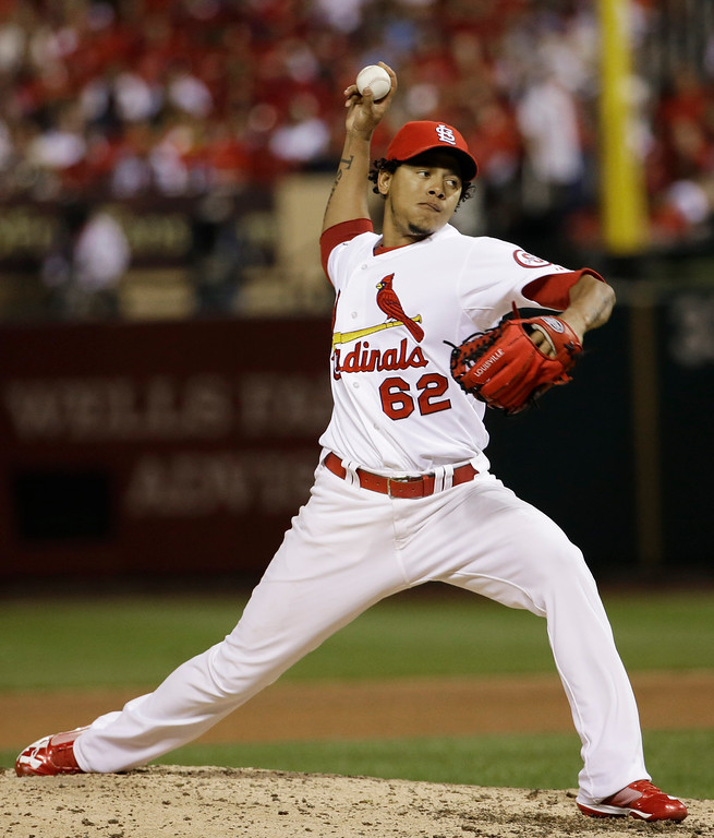 . St. Louis Cardinals relief pitcher Carlos Martinez (62) works against the Los Angeles Dodgers during the eighth inning of Game 1 of the National League baseball championship series, Friday, Oct. 11, 2013, in St. Louis. (AP Photo/David J. Phillip)