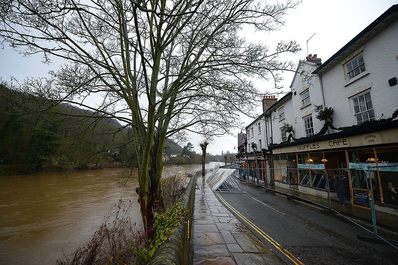 . Flood barriers protect properties alongside the swollen River Severn at Ironbridge near Telford in Shropshire on December 24, 2012. Heavy flooding across parts of Britain caused widespread road and rail disruption, wreaking havoc on Christmas travel plans while rescuers worked to evacuate people from the hardest-hit communities. ANDREW YATES/AFP/Getty Images