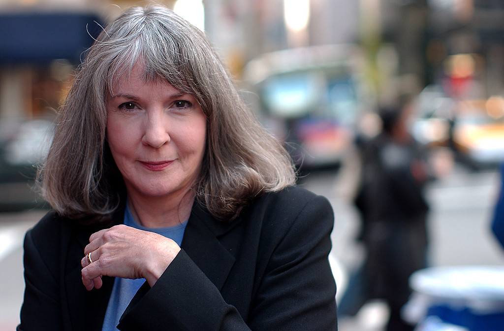 . FILE - In this Oct. 15, 2002 file photo, mystery writer Sue Grafton poses for a portrait in New York. Grafton has died in Santa Barbara, Calif., at the age of 77. Her daughter, Jamie Clark says her mother passed away Thursday night, Dec. 28, 2017, after a two-year battle with cancer and was surrounded by family.  (AP Photo/Gino Domenico, file)