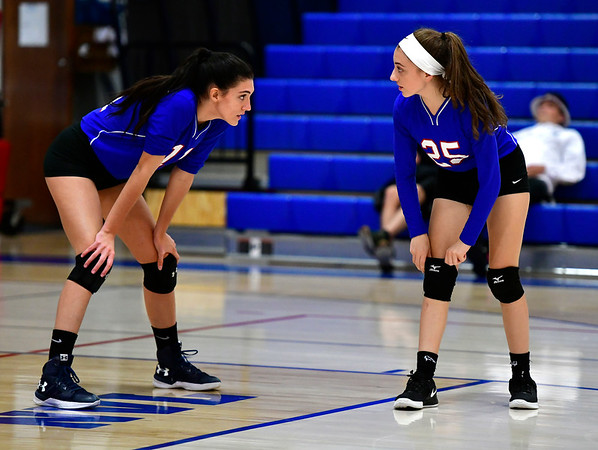 10/11/2019 Mike Orazzi | StaffrSt. Paul's Olivia Genovese (11) and Emily Esposito (25) during Thursday nights girls volleyball with Torrington in Bristol.