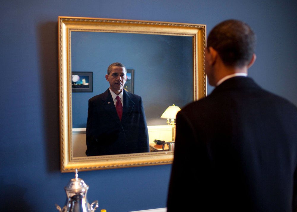 "Description of . Jan. 20, 2009 ""President-elect Barack Obama was about to walk out to take the oath of office. Backstage at the U.S. Capitol, he took one last look at his appearance in the mirror."" (Official White House photo by Pete Souza)"