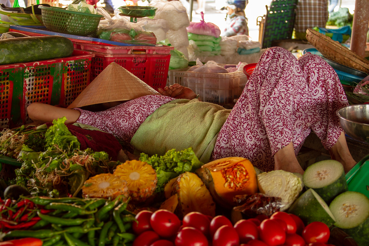 Market Vendor Resting in Hoi An, Vietnam