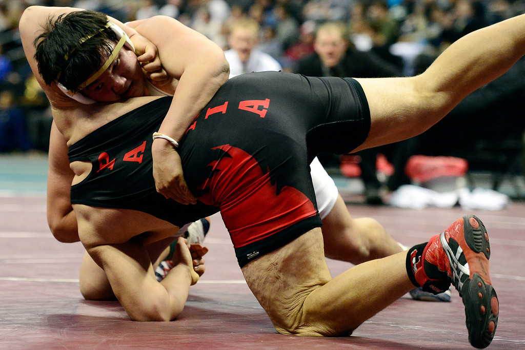 . DENVER, CO - FEBRUARY 23: Keaton Sameshima earns a third period fall against Paonia\'s Tony Darling in the class 2A 285-pound final during the Colorado State High School Wrestling Championships. The state\'s top wrestlers squared off in four classes in front of a near-capacity crowd at the Pepsi Center. (Photo by AAron Ontiveroz/The Denver Post)