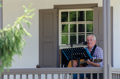 KITCHENER, Ont. (23/07/2016) - Mill Muir performs on the Schneider Haus porch during the Schneider Creek Porch Party Saturday evening in Kitchener, Ont.  Muir has played around Scotland before coming to Canada in 1980.  His music is a mix of Traditional Scottish and Irish, to older Country and Pop Classics.  Photos by Alicia Wynter/The Record