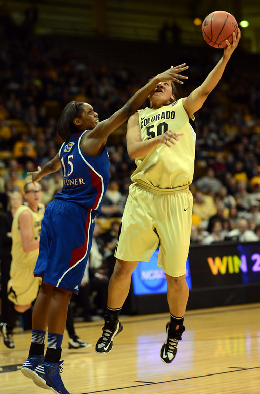 . BOULDER, CO. - MARCH 23: Chelsea Gardner of Kansas Jayhawks (15), left, pressures Jamee Swan of Colorado Buffaloes (50) during the first round of the 2013 NCAA women\'s Basketball Tournament at Coors Events Center. Boulder, Colorado. March 23, 2013. Kansas won 67-52. (Photo By Hyoung Chang/The Denver Post)