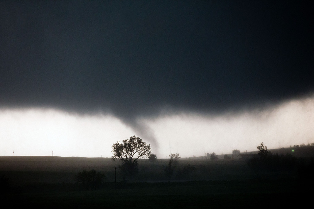 . A tornado touches down near El Reno, Okla., Friday, May 31, 2013, causing damage to structures and injuring travelers on Interstate 40. I-40 has been closed after severe weather rolled through the area. (AP Photo/Omaha World-Herald, Chris Machian)