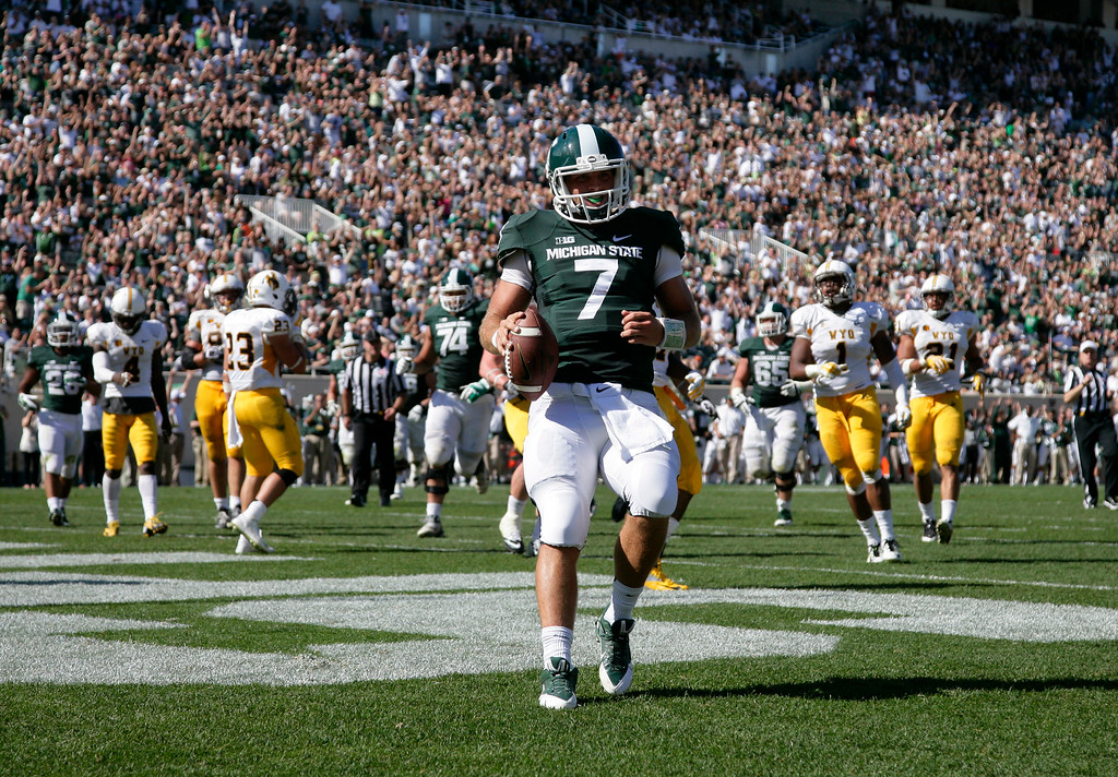 . Michigan State quarterback Tyler O\'Connor (7) scores a touchdown on a 12-yard keeper against Wyoming during the fourth quarter of an NCAA college football game, Saturday, Sept. 27, 2014, in East Lansing, Mich. Michigan State won 56-14. (AP Photo/Al Goldis)