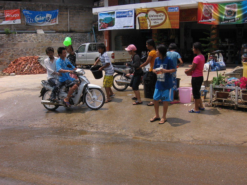 Soaking riders at Doi Mae Salong, in the far throws of northern Thailand's Chiang Rai province.