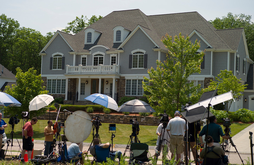 . Members of the news media are set up on the street across from the home of New England Patriots tight end Aaron Hernandez in North Attleboro, Massachusetts, USA 21 June 2013. The body of 27-year-old Odin Lloyd,a semi-pro football player and an acquaintance of Hernandez, was found 17 June 2013 in a industrial area about 1 mile (1.6 km) from the home of Hernandez. According to media reports, police have issued an arrest warrant for Hernandez on alleged obstruction of justice charges.  EPA/CJ GUNTHER