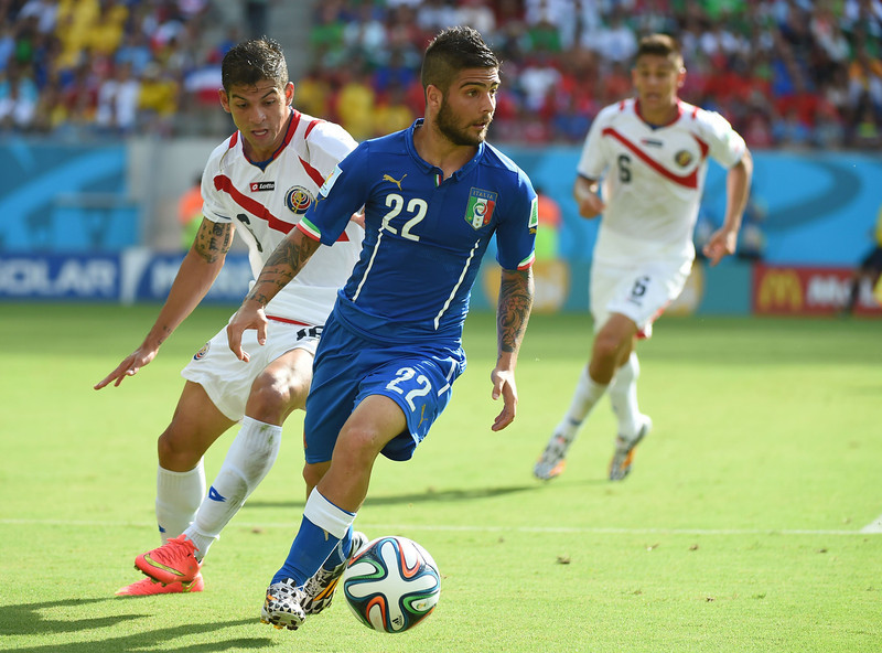 . Italy\'s forward Lorenzo Insigne (C) and Costa Rica\'s defender Cristian Gamboa (L) vie for the ball during a Group D football match between Italy and Costa Rica at the Pernambuco Arena in Recife during the 2014 FIFA World Cup on June 20, 2014. (EMMANUEL DUNAND/AFP/Getty Images)
