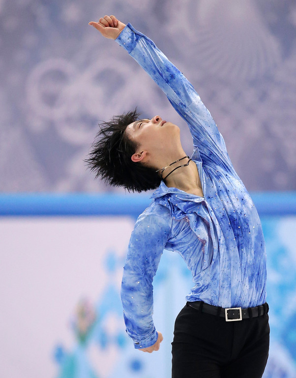 . Yuzuru Hanyu of Japan competes in the men\'s short program figure skating competition at the Iceberg Skating Palace during the 2014 Winter Olympics, Thursday, Feb. 13, 2014, in Sochi, Russia. (AP Photo/Bernat Armangue)
