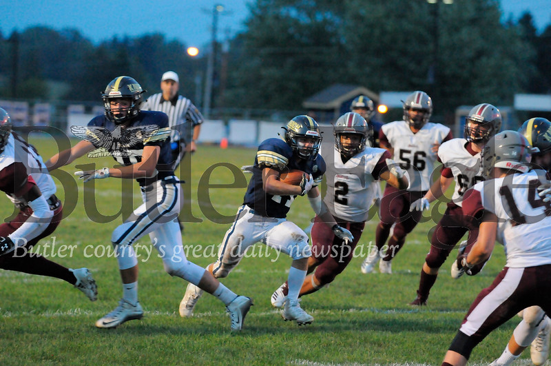 Knock #11 Noah Cetner runs past Ambridge #2 Deyvon Gill-Martin during a game at Knoch Stadium on Friday September 21, 2018. (Jason Swanson photo)