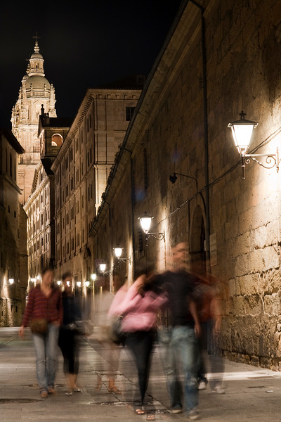 Compañia (Company) Street by night, with the Pontifical University (right) and the Clergy church (background), town of Salamanca, autonomous community of Castilla and Leon, Spain