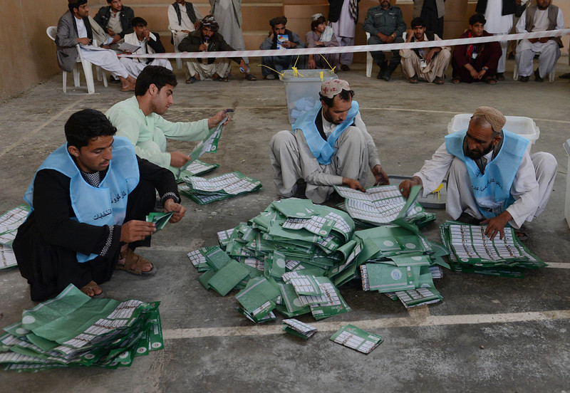 . Afghan election officials count ballot papers at the end of polling in Kandahar on April 5, 2014. Afghans voted in large numbers  to choose a successor to President Hamid Karzai in the country\'s first democratic transfer of power as US-led forces end their 13-year war. (BANARAS KHAN/AFP/Getty Images)