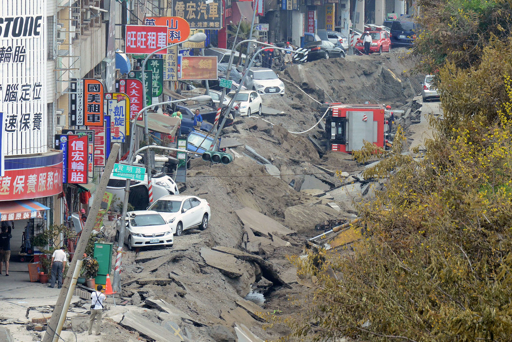 . A general view shows the damaged road after the gas explosions in southern kaohsiung on August 1, 2014.  A series of powerful gas blasts killed at least 24 people and injured up to 271 in the southern Taiwanese city of Kaohsiung, overturning cars and ripping up roads, officials said.  AFP PHOTO / SAM YEH/AFP/Getty Images